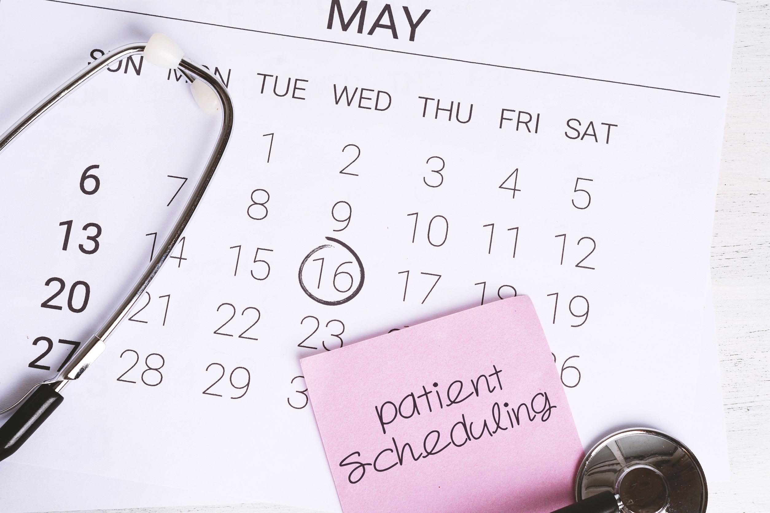 Stethoscope on calendar page. Regular medical examination concept.